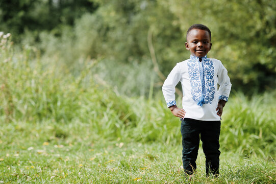 Portrait of african boy kid in traditional clothes at park.