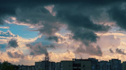 Fotobehang - Epic beautiful storm clouds passing over city skyline background at sunset. Part 1 of 2. Timelapse, 4K UHD.