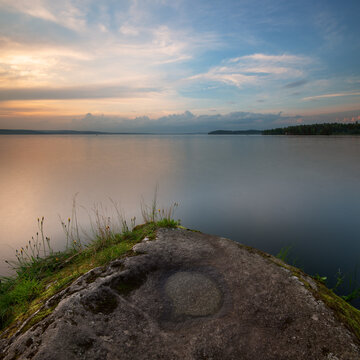 Landscape captured at sunset with textured foreground and long exposure