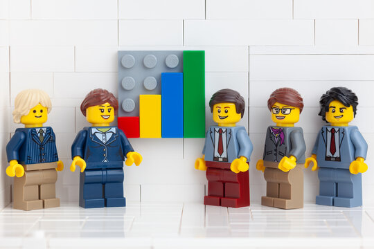 Tambov, Russian Federation - November 14, 2020 Lego minifigure businesspeople having a meeting in their office and showing the results of their successful teamwork.