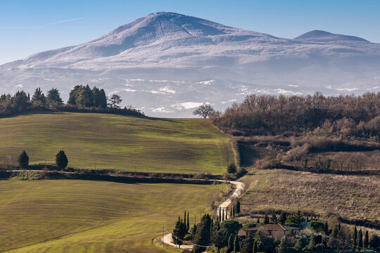 Beautiful panoramic view of Monte Amiata covered with snow from Monticchiello, Siena, Tuscany, Italy