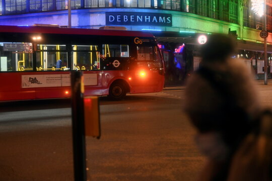 A bus drives past a Debenhams department store at Clapham Junction, in London