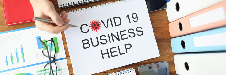 Man and woman are holding ballpoint pens over document covid 19 business help top view. Planning...