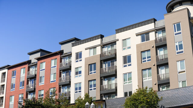 Exterior view of modern apartment building offering luxury rental units in Silicon Valley; Sunnyvale, San Francisco bay area, California