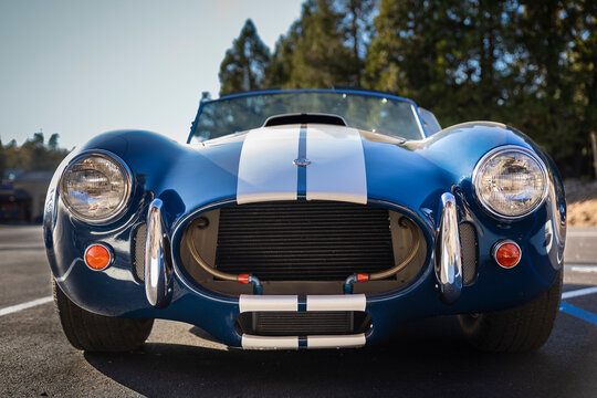 Placerville, USA - November 25, 2020: Classic rare American muscle car, convertible vintage blue 1967 Ford Shelby Cobra 427