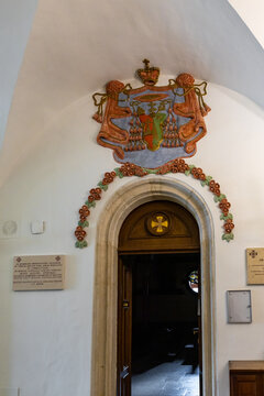 The coat of arms made of gypsum over the entrance to the church in the Austrian Hospice in the old city of Jerusalem in Israel