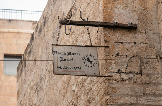 The sign of Black Horse hostel on the Lions Gate Street in the old city of Jerusalem, in Israel