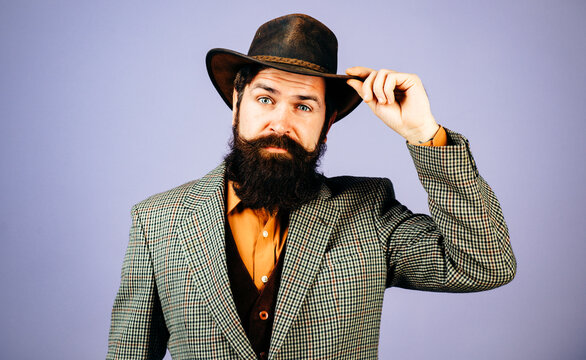 Retro handsome man, portrait face of serious bearded hipster with vintage hat. Vintage fashion vogue.