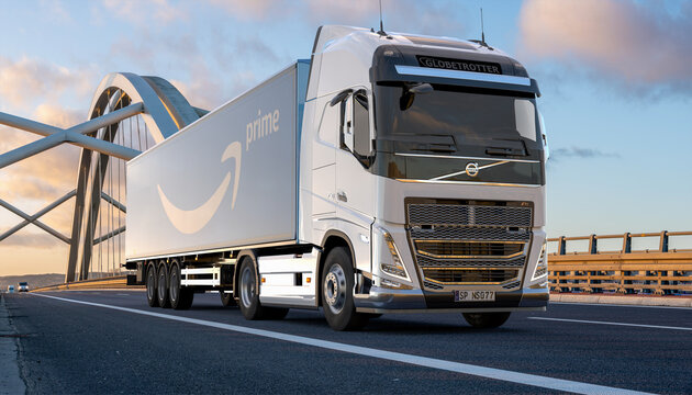 Volvo truck with a trailer bearing the Amazon Prime logo
