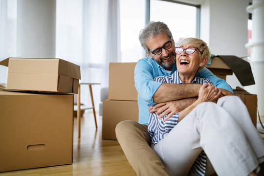 Happy retired senior couple moving into a new home, apartment.