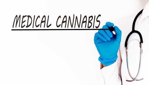 Doctor writing word Medical Cannabis Medical concept on white background