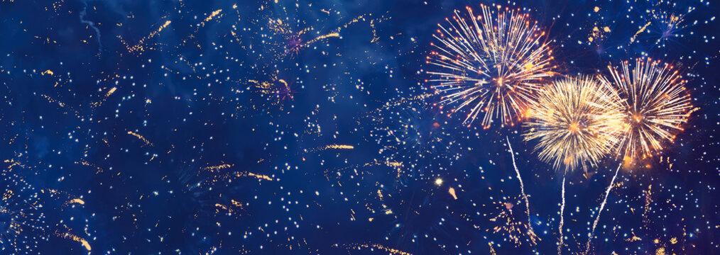 Holiday background of glitter lights and fireworks