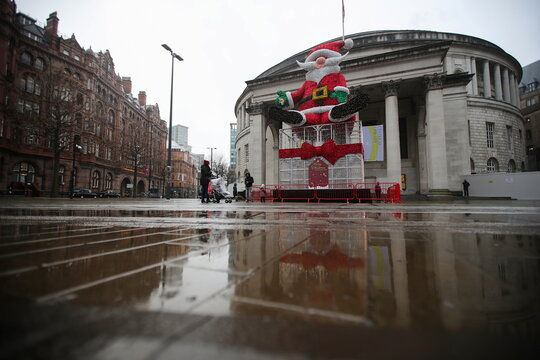 A giant Santa Claus statue is seen in Manchester