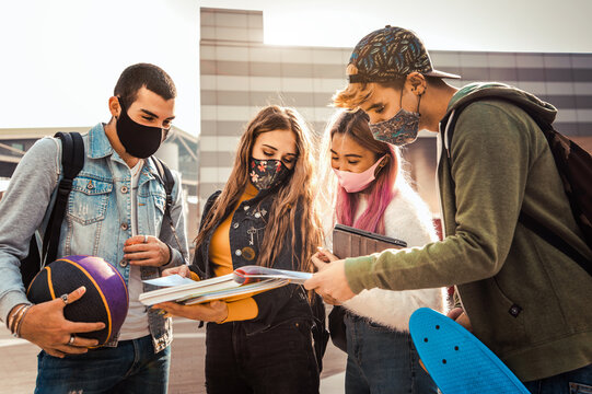 Portrait of a group of students covered by face masks. New normal lifestyle concept with young people going to school.