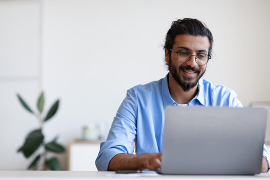 Recruitment Concept. Smiling Western Guy Using Laptop, Searching Jobs Online In Internet
