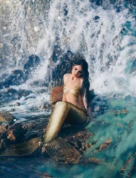 Fantasy woman real mermaid myth goddess of sea. Art goldfish creative costume ocean siren sexy body spa relaxation. mystic spirit of lake river floats swimming in water. sunset nature Magic sun light