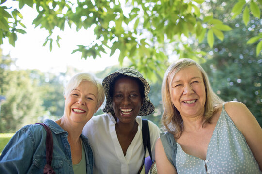 Portrait happy beautiful senior women friends in summer park