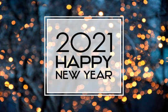 2021 Happy New Year christmas golden bokeh lights background frame stock images. 2021 New Year sign on a glowing background. Happy New Year 2021 night defocused lights texture greeting card images