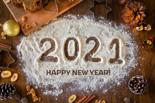 Creative Happy New Year 2021 greeting card for home baker, baking, numbers made out of flour, top view, wish