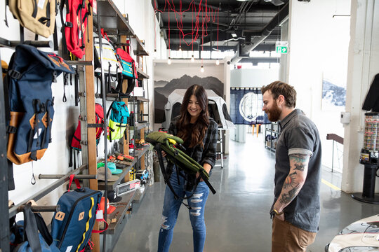 Couple shopping for backpack in sporting goods store
