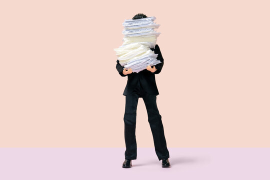 male businessman holding a stack of papers, all hands on deck concept