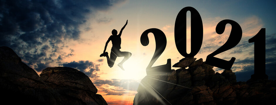 banner of man jumping on cliffs to 2021 new year