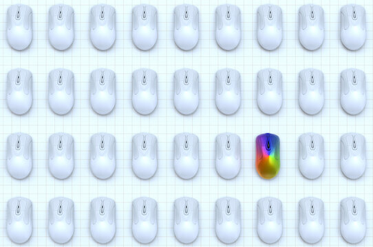 Rainbow computer mouse among rows of white computer mice