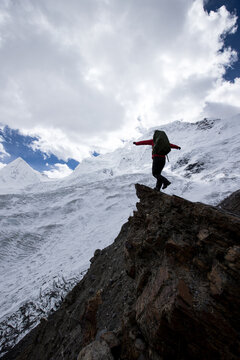 Woman hiker  enjoy the view on winter mountain top