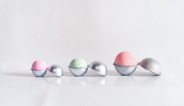 Bath bombs in various sizes coming out of metal molds