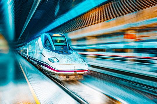 Modern hi-speed passenger train, in  movement (motion).