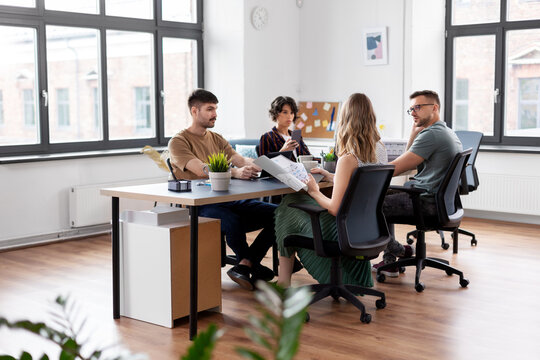 business, people and corporate concept - team of startuppers or ui designers working at office