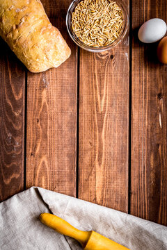 traditional bread with rolling-pin wooden table background top view space for text