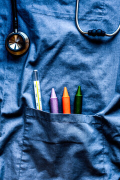 Child health care with stethoscope and thermometer in doctors pocket top view mock up