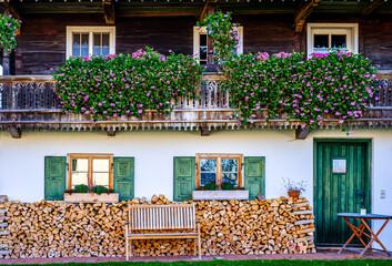 Wall Mural - typical bavarian farmhouse near the alps