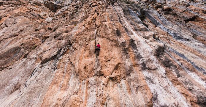 A strong man climbs a rock, Rock climbing in Turkey.