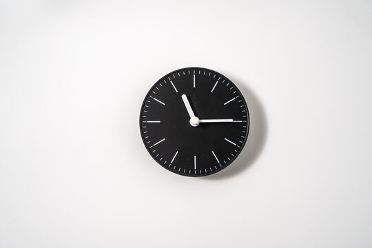 close up of an office clock on white background with clipping path