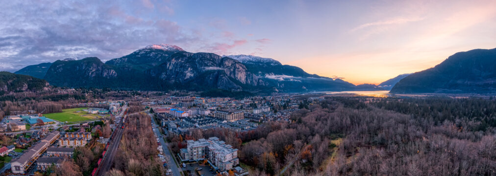 Aerial Panoramic View of Residential Homes in a touristic city. Colorful Sunset Sky. Taken in Squamish, North of Vancouver, British Columbia, Canada.