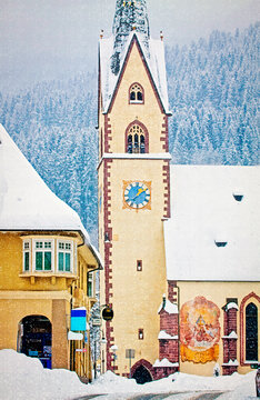 View of  Koetschach-Mauthen center, characteristic Austrian village in Carinthia region on wintertime, quite a white Christmas vintage postcard