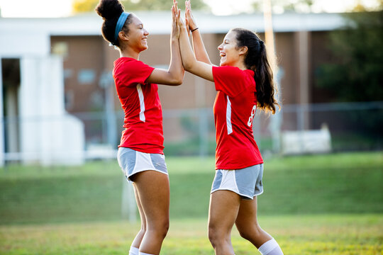 Teen girls celebrating after successful goal