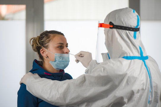 Medical staff member with mask, rubber gloves and protective equipment in covid testing center