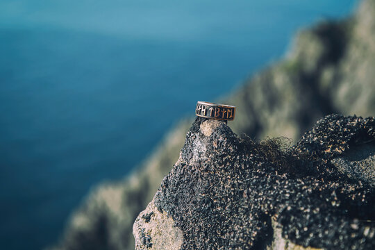 Ring wiith the runes on the rock in Norway