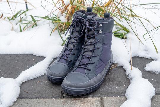 A Pair of Women's New Waterproof Winter Boots in a Snowy Garden