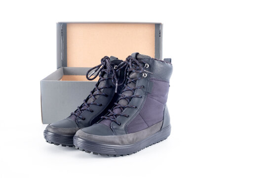 A Pair of Women's New Waterproof Winter Boots and a Shoe Box Isolated on White Background