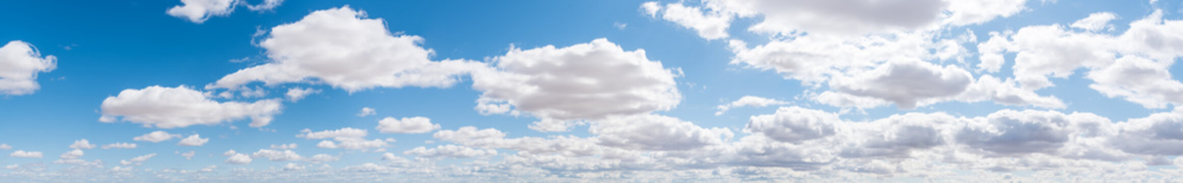 Blue Sky with Puffy White Clouds Panorama Background-2