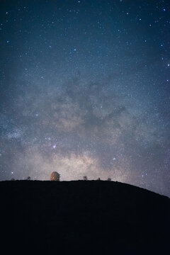 Low angle of breathtaking sky with Milky Way over silhouette of dark hill in highlands in Tenerife