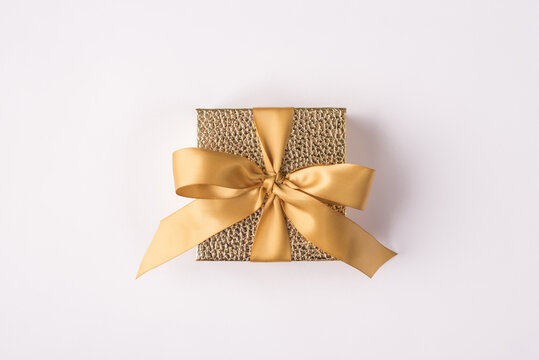 Above top close up view photo of little cute beautiful fashionable box with bow isolated white color background