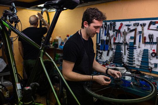 Mechanic repairing bike wheel