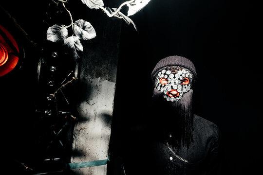 Anonymous in bright mask of large rhinestones