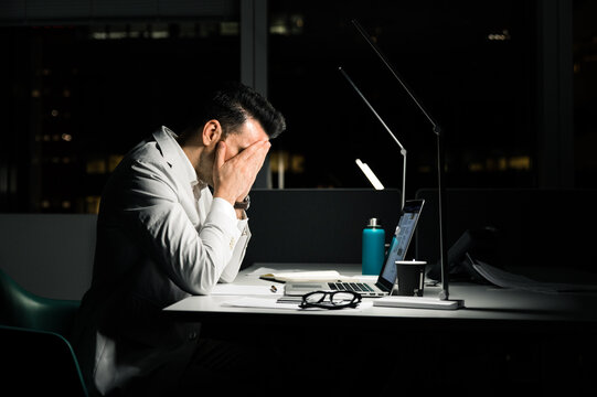 Overworked executive male employee in office