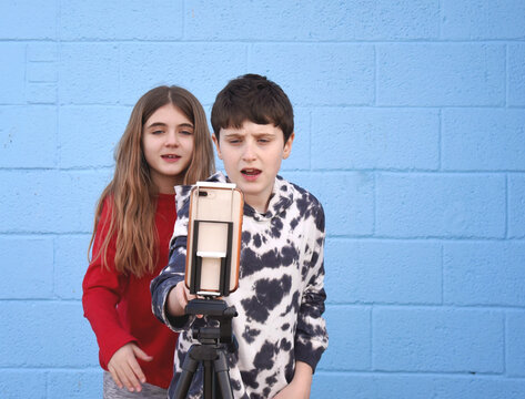 Tween Friends Getting Ready to Record Using Smart Phone